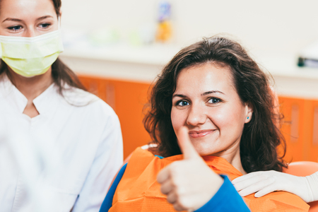 tooth extraction: Happy female  patient after tooth extraction