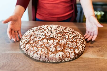 unsliced: Closeup of traditional baked bread on a table Stock Photo
