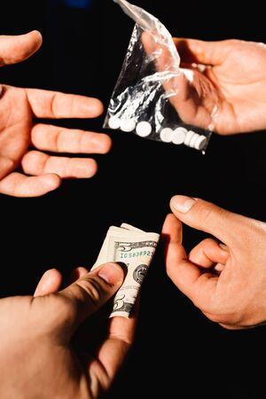dealers: Closeup of drug dealers hands taking money for drugs Stock Photo