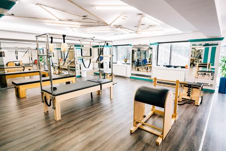 reformer: Trapeze table, reformer, ladder barrel in a pilates room