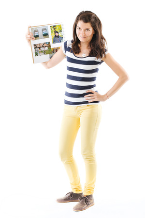 photo album: Young smiling woman posing with photo album - isolated on white