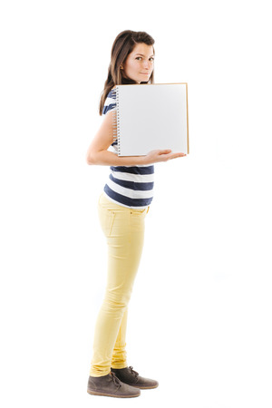 writable: Standing woman holding a writable card - isolated on white