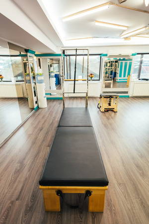 trapeze: Pilates room having the equipment ready for clients. Focus on trapeze table.