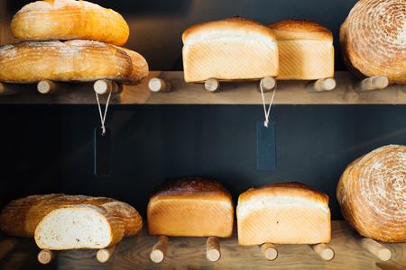 unsliced: Closeup of an assortment of bakery foodstuffs on shelves