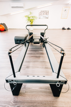 reformer: Universal reformer - pilates equipments close-up ready to be used.