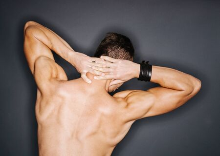 trapezius: Back of a muscular mans perfect trapezius and triceps