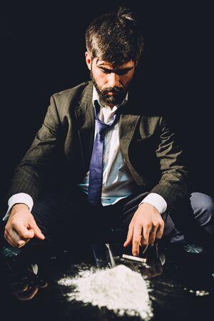 sniff: Man preparing to sniff cocaine