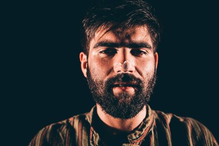 hallucination: Closeup of a bearded junkie having hallucination