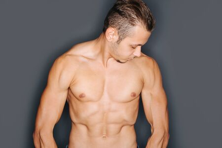 tense: Torso of a tense man with perfect abdominal and chest muscles Stock Photo