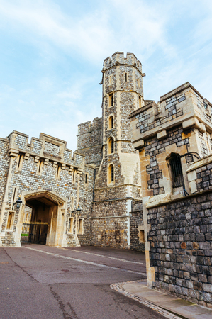 windsor: Windsor castle stone walls in a sunny day Editorial