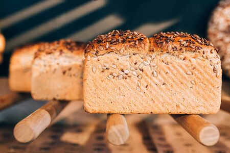 unsliced: View of bread with seeds on bakerys shelf