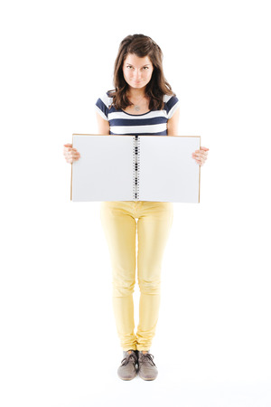 writable: Standing woman holding an empty scrapbook in her hands - isolated on white Stock Photo