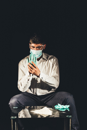 drug dealer: Drug dealer putting on gloves for cocaine preparation