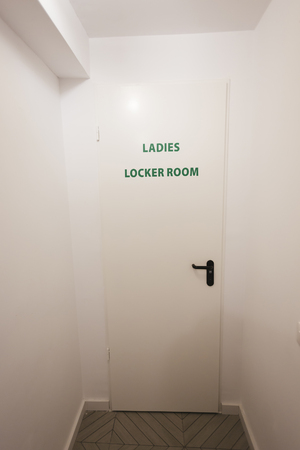 room door: Door with the sign of Ladies locker room Stock Photo