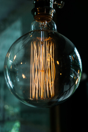 incandescent: Old-fashioned incandescent bulb ,close-up