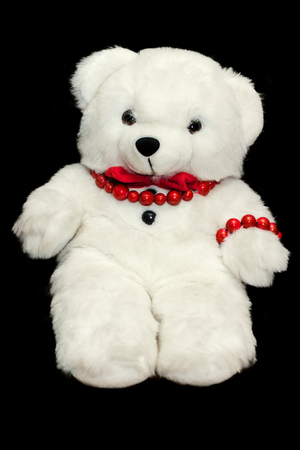 Teddy toy bear on black background. Cute animal. Child present Stock Photo