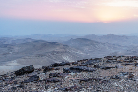 Magic dawn sunlight landscape of judean desert in Israel. Outdoor morning nature and beautiful sunlight cloud mountains and sand Stock Photo