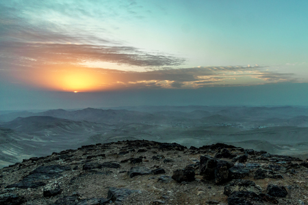 Magic colorful morning sunrise in aged judean desert Israel. Landscape of dawn on holy land with beautiful nature clouds, mountains and rocks. Travel tourism and nobody on photo Stock Photo