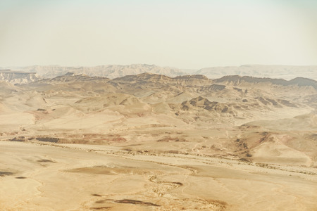 Summer travel to israel negev desert full of sand. Landscape view on crater ramon. Middle east tourism 스톡 콘텐츠