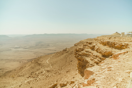 Hot israel negev desert and crater mitzpe ramon. Golden sand land, mountains. Beautiful place for tourism.