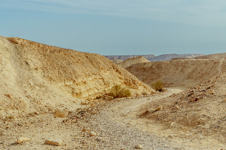 Landscape horizon view on desert mountains and sky near the dead sea in Israel. Infinity valley panorama of lone sand, rocks, hills and stones. Waterless middle east territory, silence and heat.
