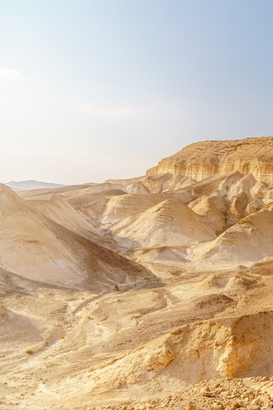 Beautiful nature desert in dry judean picturesque wilderness. Outdoor scenic landscape of mountains, sand and rocks near the dead sea. Travel in middle east in holy land in Israel Stock Photo