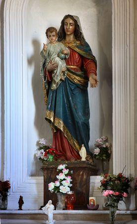 sainthood: Mother of God holding little