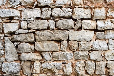 Old stone wall builded on old way Stock Photo - 2264217