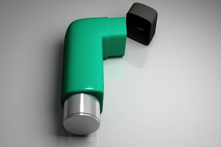 asthmatic: Inhaler in isolated background  Stock Photo