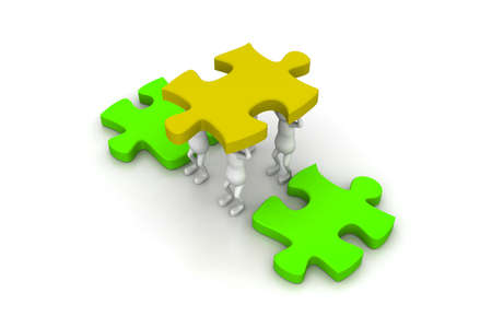 puzzling: A team works together to lower the final puzzle  Stock Photo