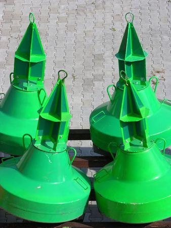 nautic: Green buoies on land