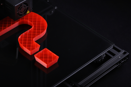 oblique top view on 3D-printer with big question mark made from red plastic - dark surrounding with classy light mood - technology opportunity concept with copy space for text 版權商用圖片