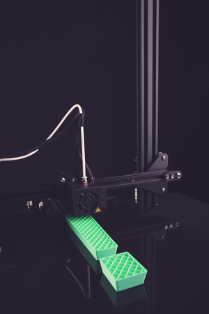 view on 3D-printer manufacturing big exclamation mark from green plastic in neutral matte light mood - dark surrounding - technology opportunity concept - portrait orientation 版權商用圖片