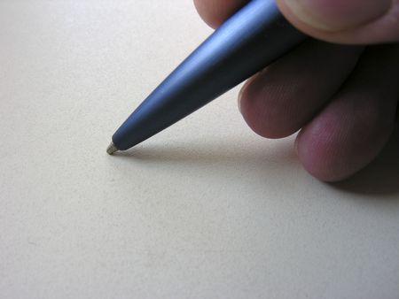 Hands beginning to write Reklamní fotografie