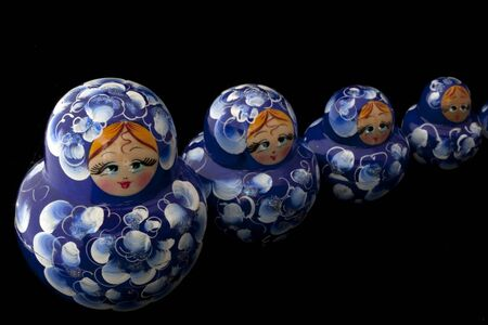 matroshka: russina doll is a row with black background