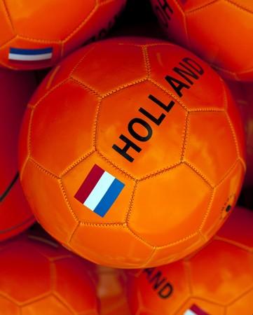 a orange soccerball with dutch flag photo