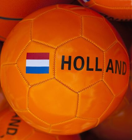 a orange soccerbal with the dutch flag photo