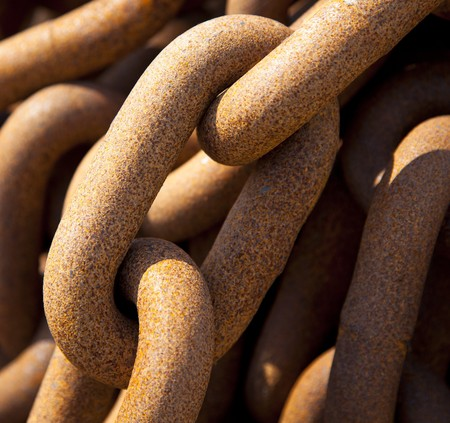 a old rusty chain in detail photo