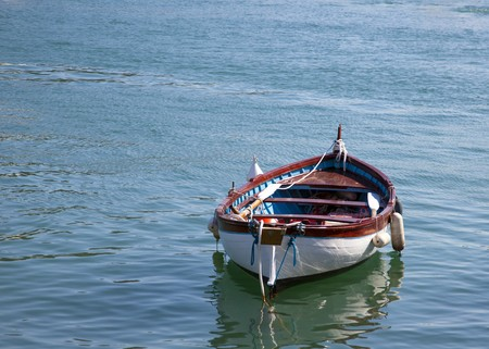 italian fish boats in blue water
