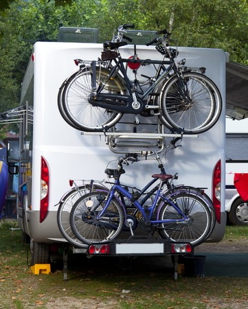 camping site: camper with bicycles on a camping site