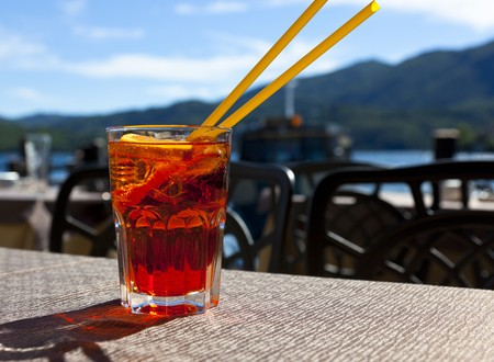 a cool drink with the lake in the background Reklamní fotografie - 7524910