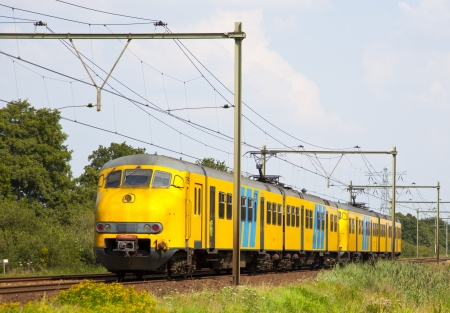 dutch train is a typical dutch landscape Reklamní fotografie - 7598612