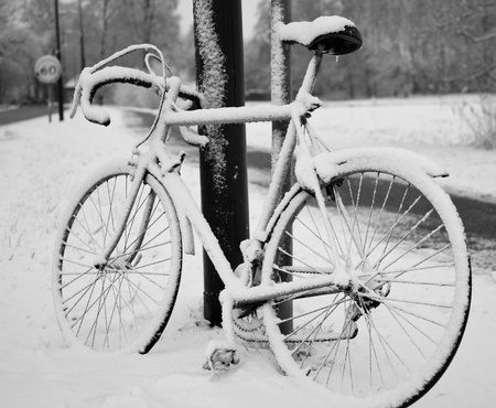 bike in the snow Stock Photo