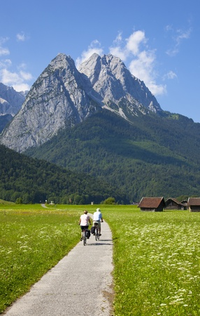 with a bicycle against mountains photo