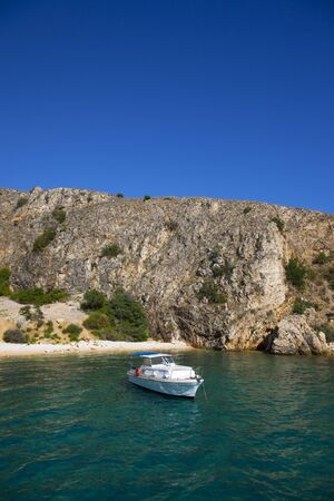 speedboat: boat anchored on a private beach