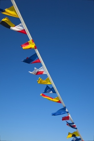 nautial flags with blue sky