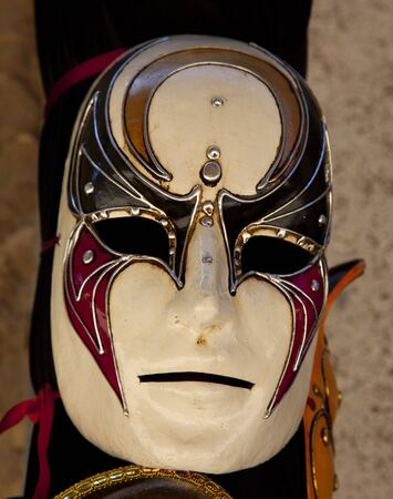 painted face mask: traditional carnival mask in Venice  Stock Photo