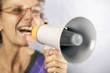 commandment: young woman shouting through a megaphone  Stock Photo