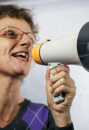 young woman shouting through a megaphone  photo