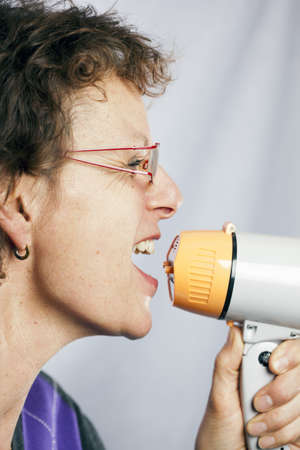 commandment: young woman shouting through a megaphone  Stock Photo